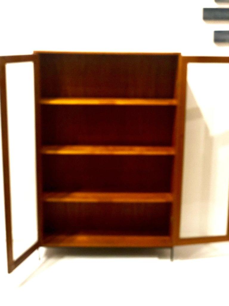 20th Century Danish Modern Teak Glass Bookcase by Dyrlund on Solid Iron Base For Sale