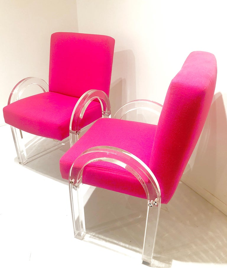 Beautiful pair of Archline Lucite armchairs. Designed by Charles Hollis Jones, circa 1980s. Freshly upholstered in a bright Mexican fuscia linen material. The arms have been polished and they have new foam. These pair of chairs are chic and elegant.