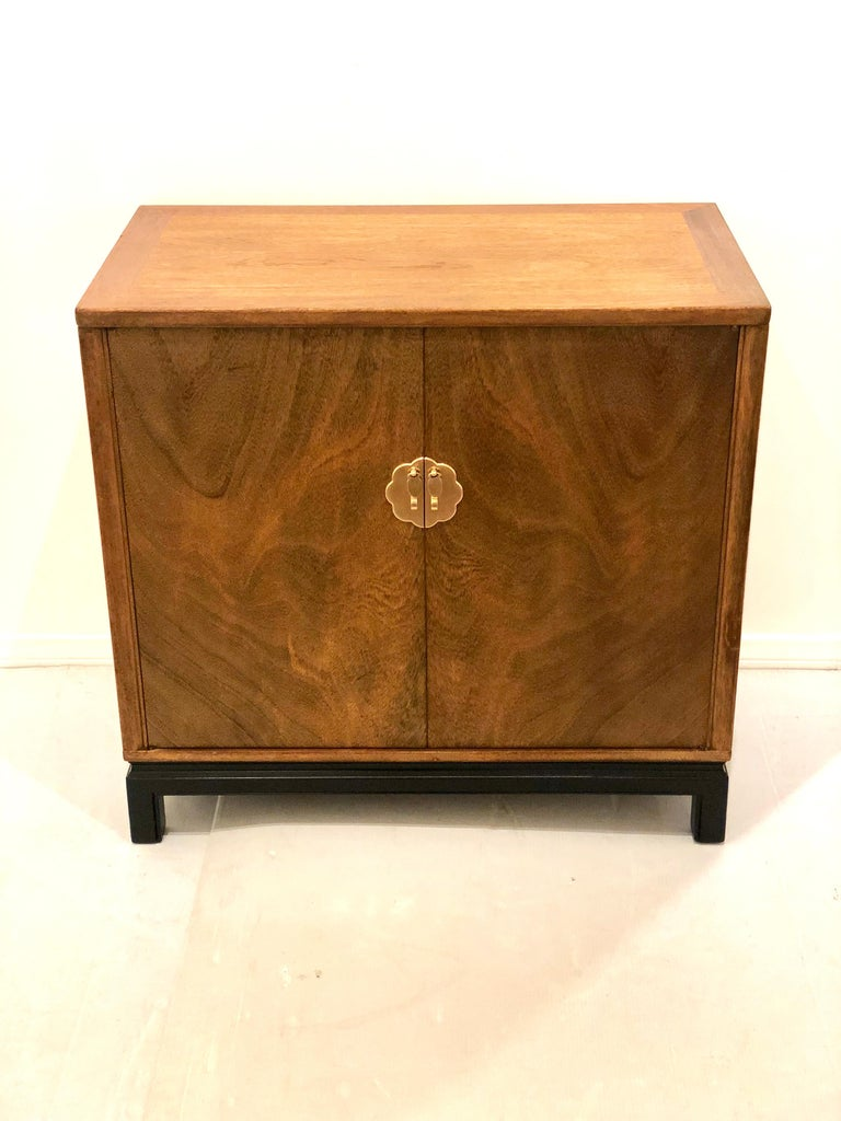 Beautiful and versatile double door cabinet by Lanstrom furniture, great quality double drawers freshly refinished in mahogany with black lacquer base, and polished brass handles, circa 1950s goes well with midcentury or Hollywood Regency.