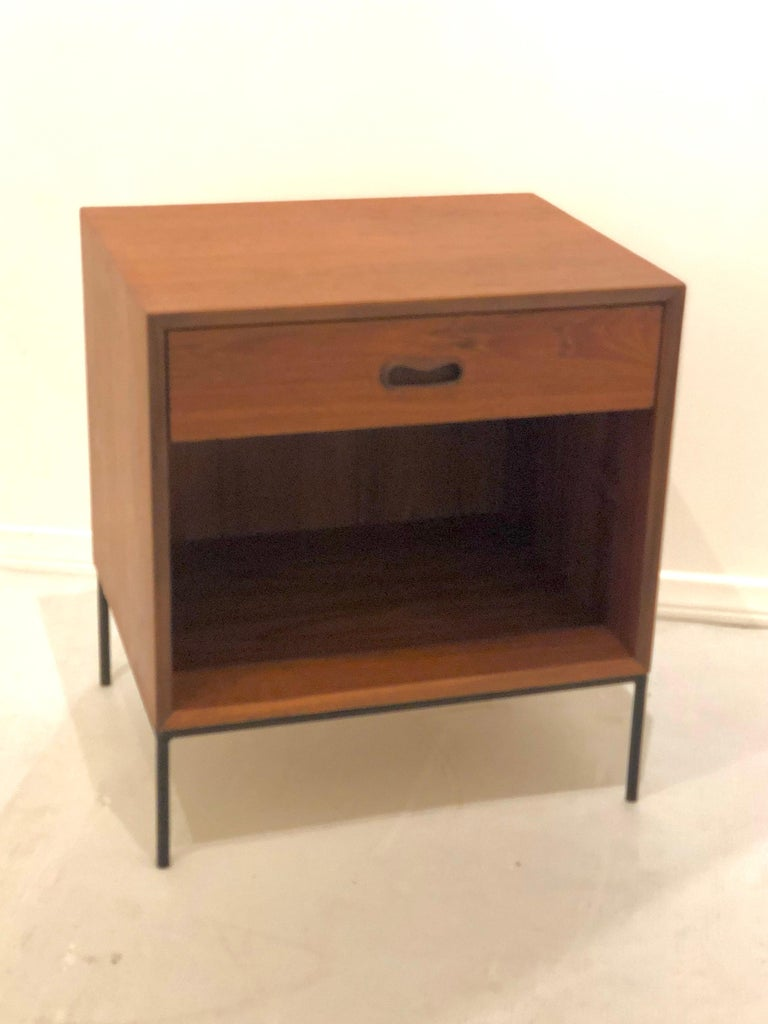 Beautiful single teak and solid iron nightstand, circa 1950s we refinished this piece and sprayed the iron base in black, its in nice condition with a small repair on the top right corner as shown, nothing major but needs to be mentioned.