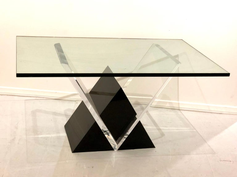 Massive solid Lucite and glass coffee table in a clear and black combination with a solid 1/2