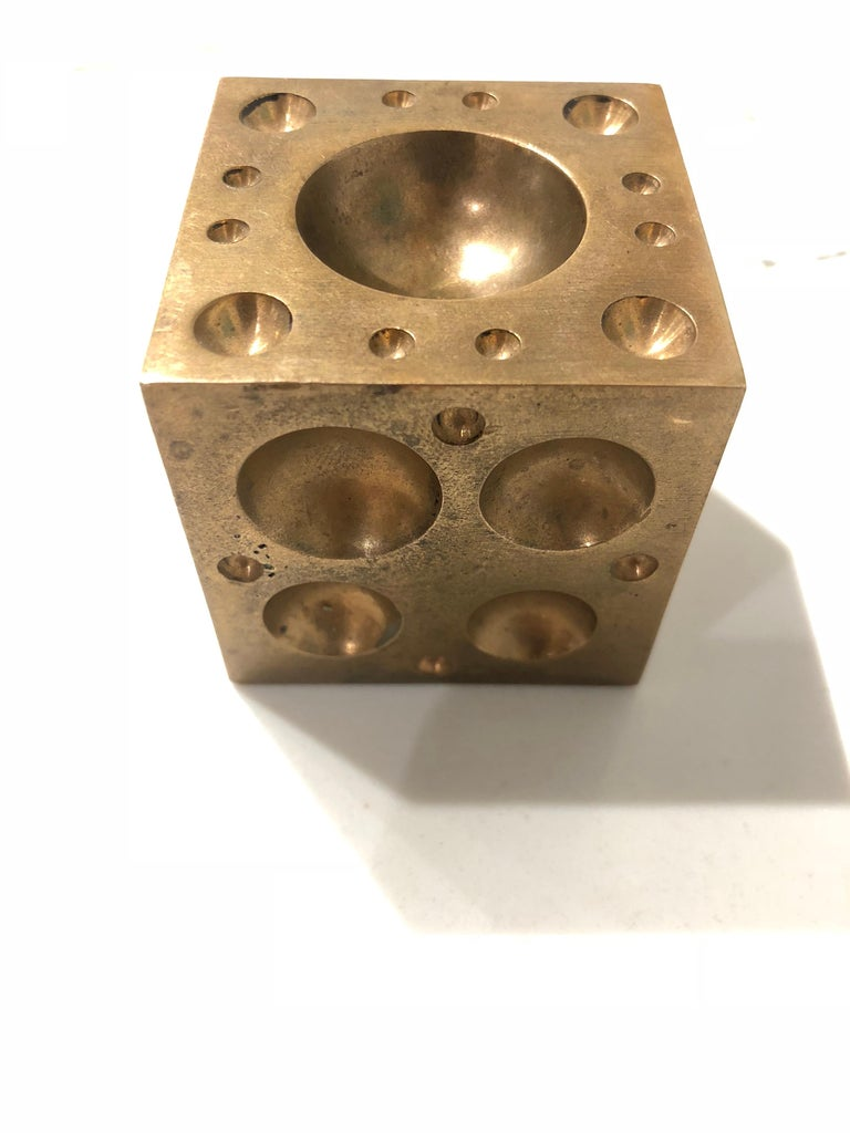 Nice and heavy unique paper weight sculpture, in solid brass each side comes with different sizes holes, circa 1970s.