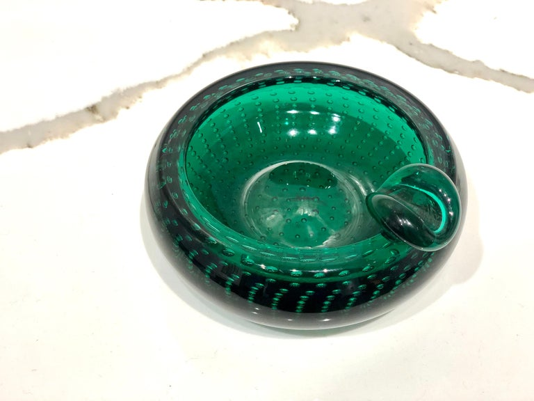 Incredible unique piece of thick green glass, simple elegant a very clean piece, no chips or scratches, circa 1970s, with air bubbles inside. Italian Murano beautiful.
