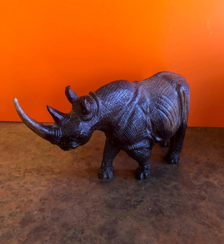 Incredibly detailed hand-carved white rhino sculpture signed by Khoza Frans, circa 1980s. The intricacy of the piece is amazing as the hide looks almost like leather; it appears to be hand carved from an African hardwood.