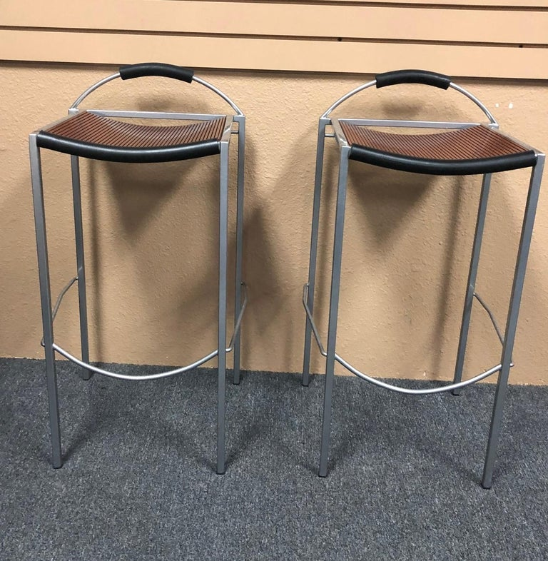 Pair of Sgabello counter stools by Maurizio Peregalli for Zeus, circa 1990s. The seats are a dark brown wood on a steel base with black rubber accents; very stylish!