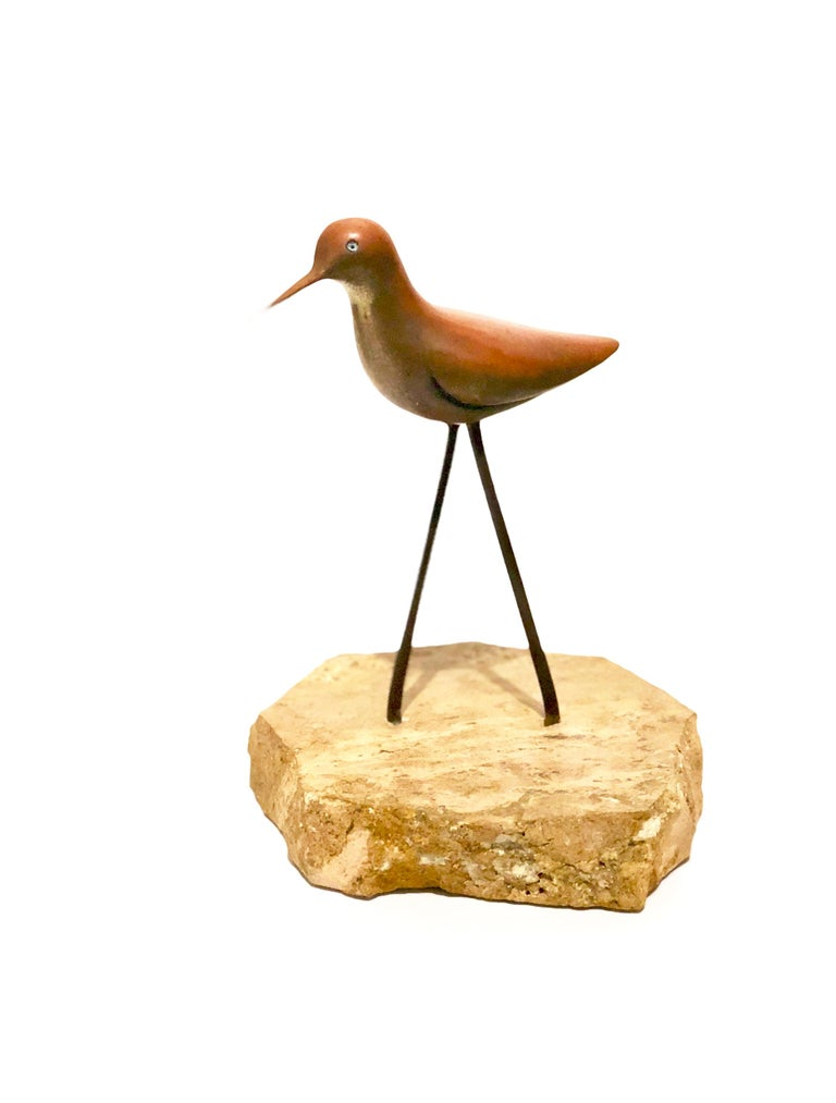 A delicate solid brass small sculpture of a bird sitting on solid marble base, circa 1970s we believe its made by Studio Jere. Great patina that can be polished if wanted.