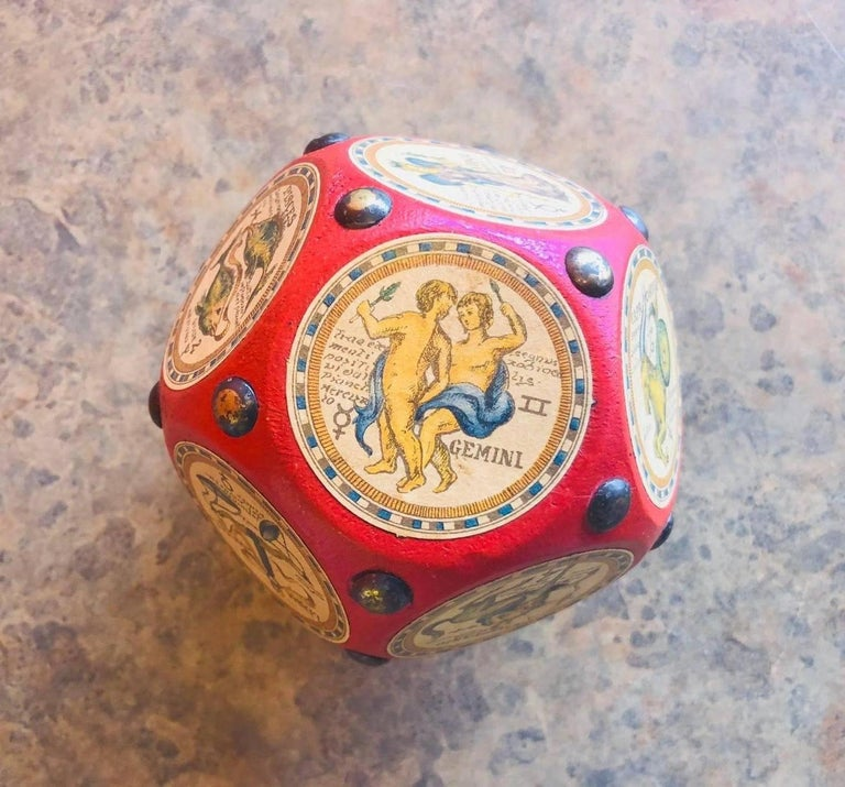 A rare Italian dodecahedron paperweight with the 12 signs of the Zodiac prominently displayed. The astrological signs are beautifully illustrated and the writing appears to be in Latin or Italian; each picture is a well crafted celestial