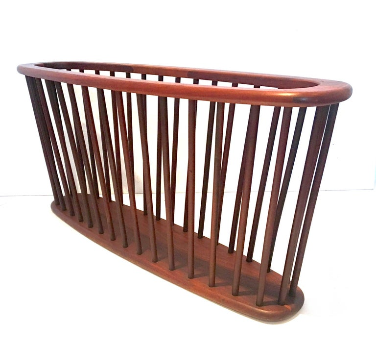 Midcentury solid walnut X large magazine rack by Arthur Umanoff, circa 1950s. Great California design in very good vintage condition.