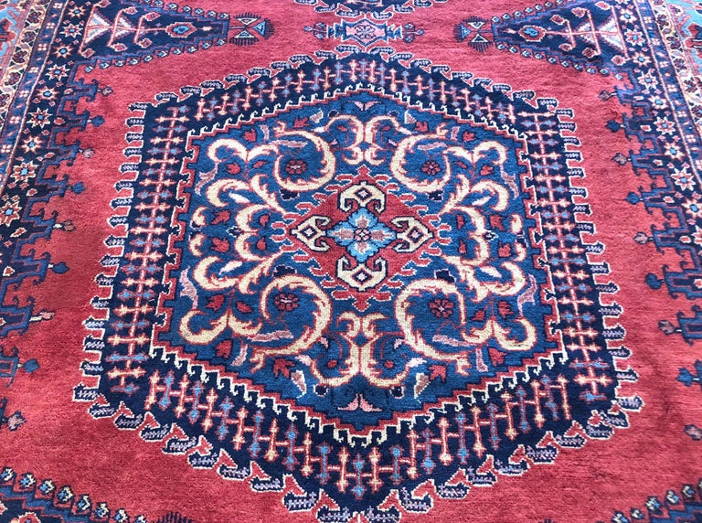 Authentic Persian Viss rug with wool pile and cotton foundation. The age of this rug is almost 50 years old. The base color is red and the border color is turquoise. This beautiful piece has an hexagonal shape medallion. The size of this rug is 7