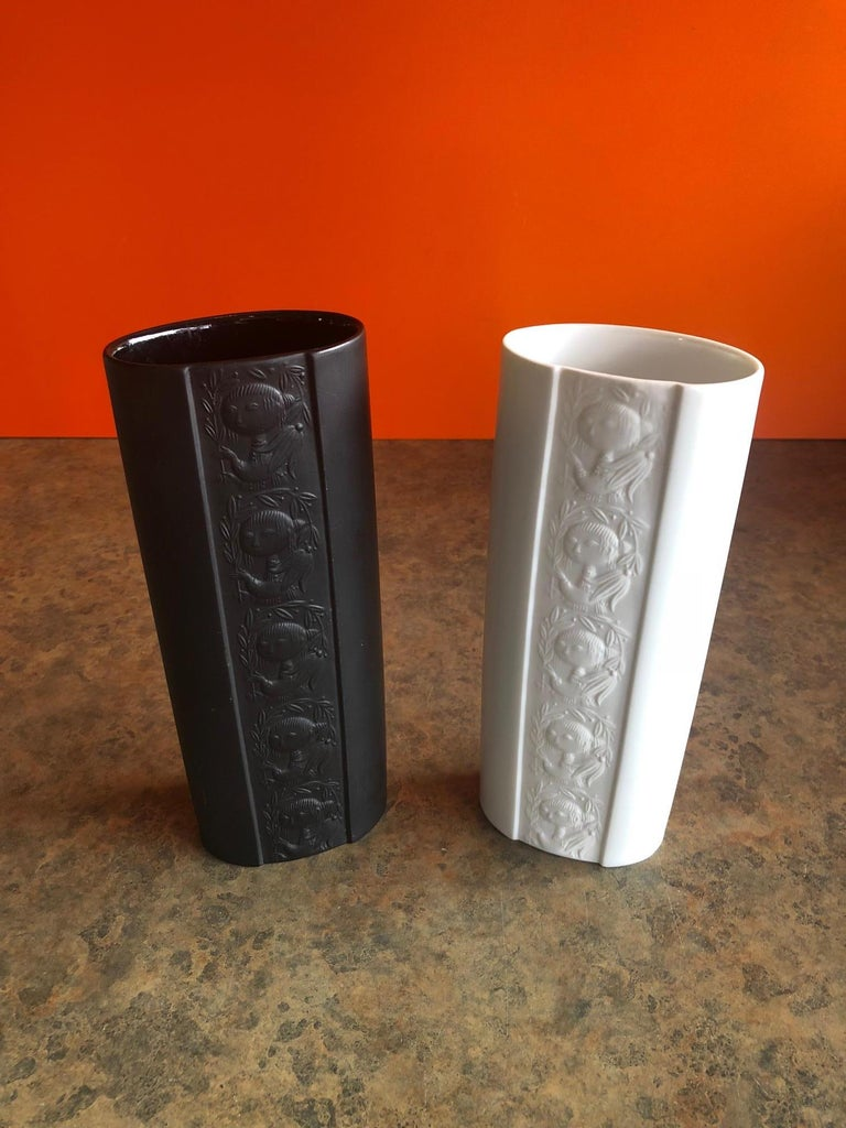 A pair of midcentury papagena vases by Danish artist-cum-designer Bjorn Wiinblad for Rosenthal of Germany as part of their extensive artist-led Studio Line series, circa 1970s.  The vases are white and black porcelain with a matte finish in