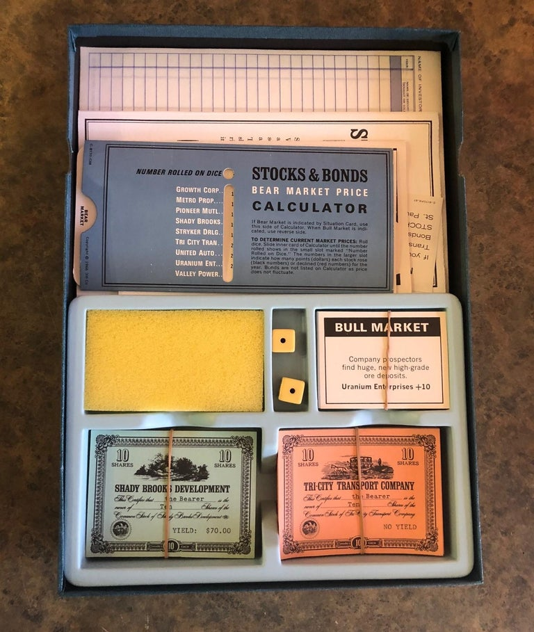 Midcentury stocks and Bonds board game by 3M, circa 1964. This set is in excellent condition and appears to have never been played. Stocks & Bonds is a