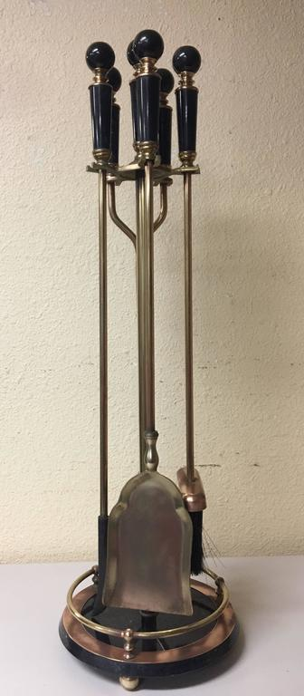 For Sale on 1stdibs - Beautiful polished brass fireplace tool set with black marble base and handles