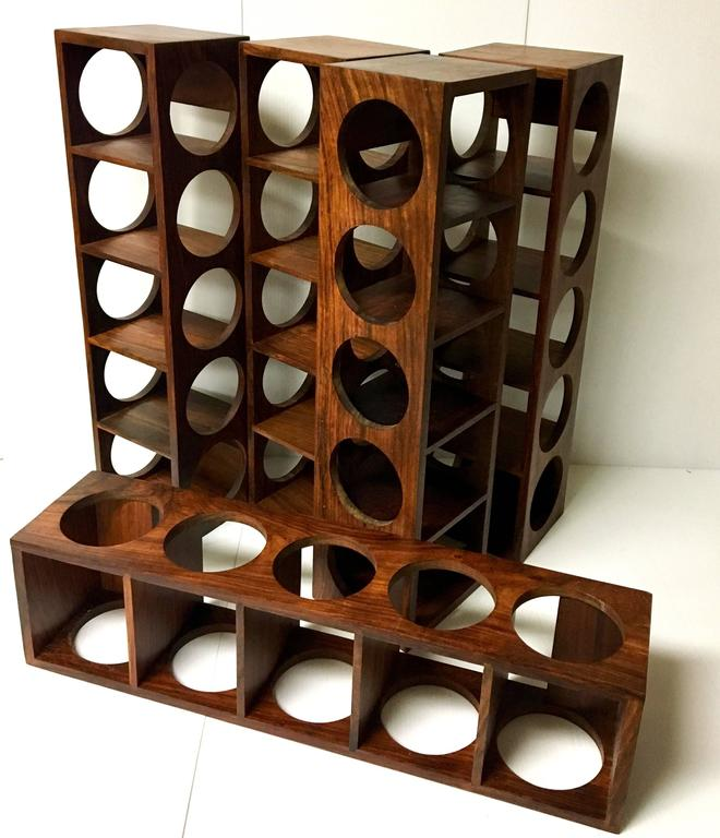 A rare Danish modern, five bottle capacity, solid rosewood wine. The racks are easy to install and in great condition. Five racks are available and they are priced individually; buy 1 or all 5!