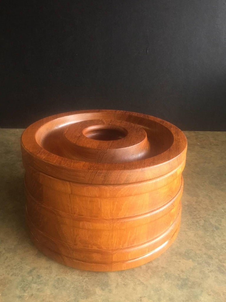 Very nice, freshly oiled, lidded, staved teak ice bucket by Jens Quistgaard for Dansk, circa 1960s. The piece is in excellent condition and retains its original black plastic ice liner; it is marked