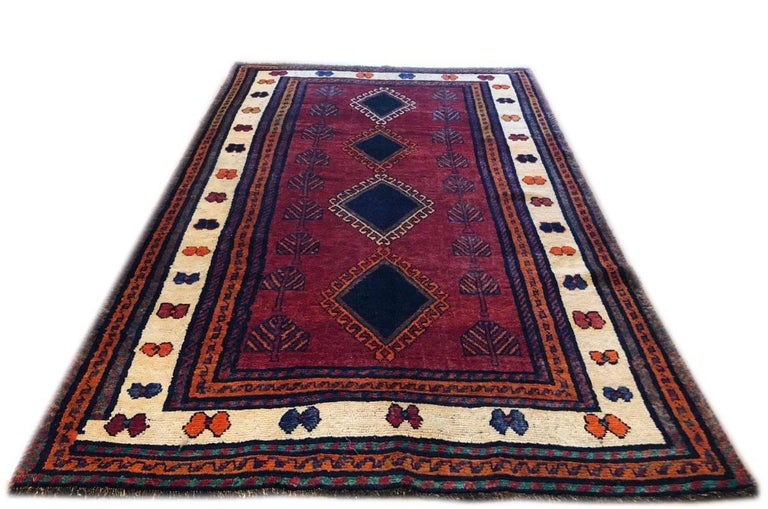 This carpet is knotted in the province of Fars in south west of Iran. Shiraz rugs have tribal and nomadic design and usually the dominant colors is bright red like this beautiful piece. The pile and foundation is wool. This rug is rustic in a good