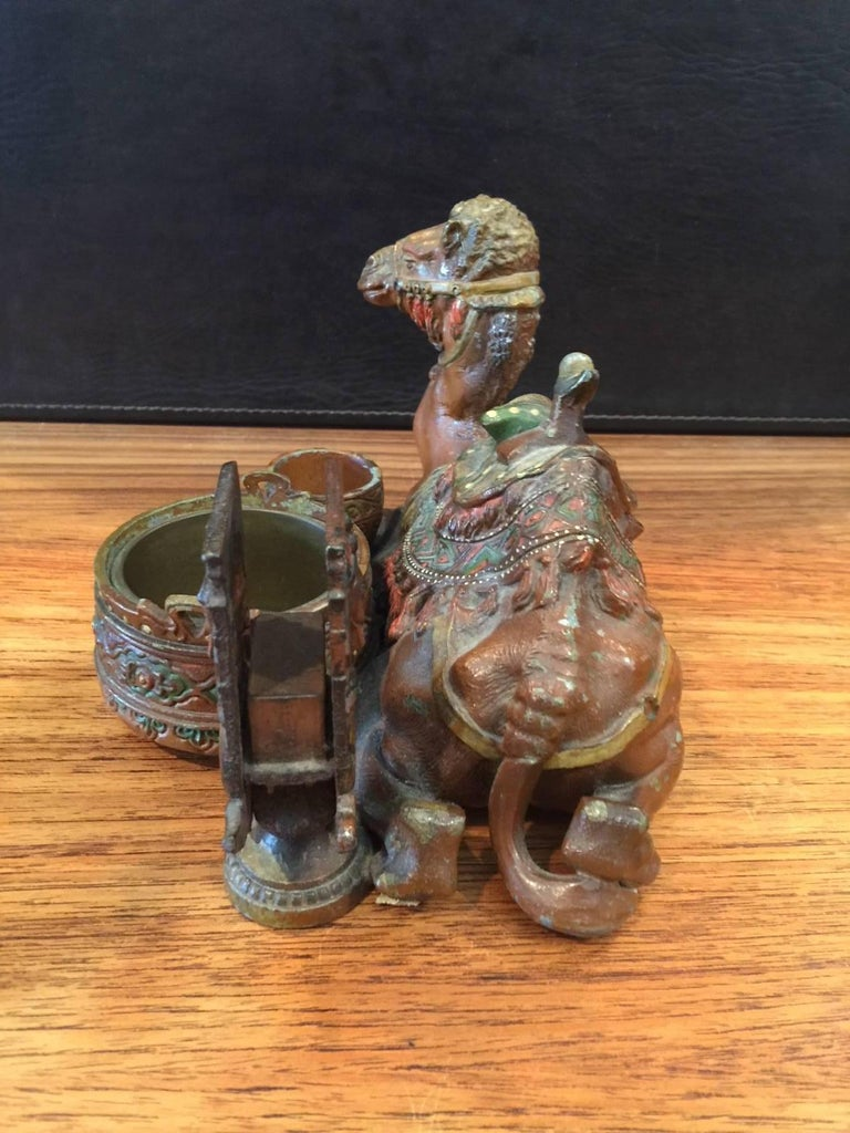 Unique white metal, cold painted, antique camel cigarette stand from Austria, circa 1900. The stand is in good shape with some chipping to the hand-painted camel (please see pictures).