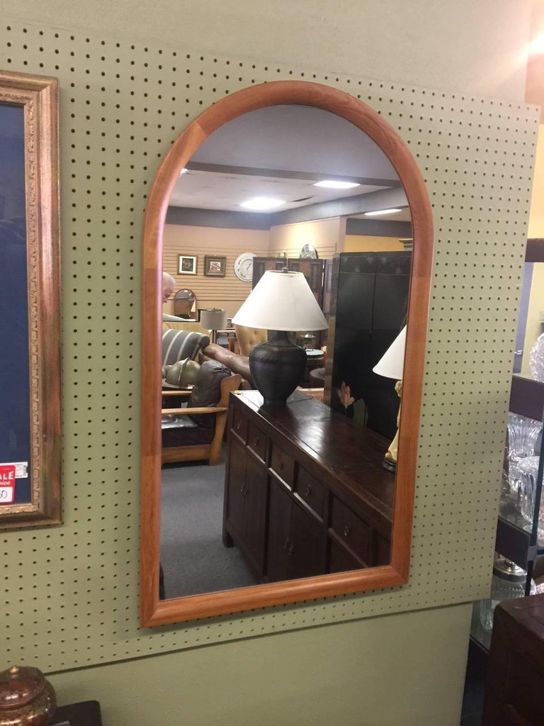 Large and impressive arched top teak mirror by Jesper International, circa 1970s. Very well constructed piece with finished back and dovetailed frame.