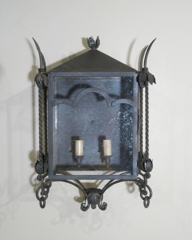 From the chandelier product line, this is our Italian wall mount, small. Iron wall mount with painted finish and clear seeded glass. Two candelabra base bulbs up to 60 watts/socket. UL listed, wired in California. Made to order, 10-12 week lead
