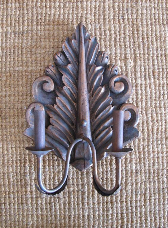 Iron Pair of Hand-Carved Sconces For Sale