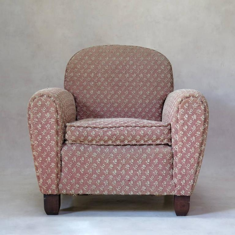 Sturdy pair of French Art Deco club chairs, upholstered in pink fabric with white floral motif.