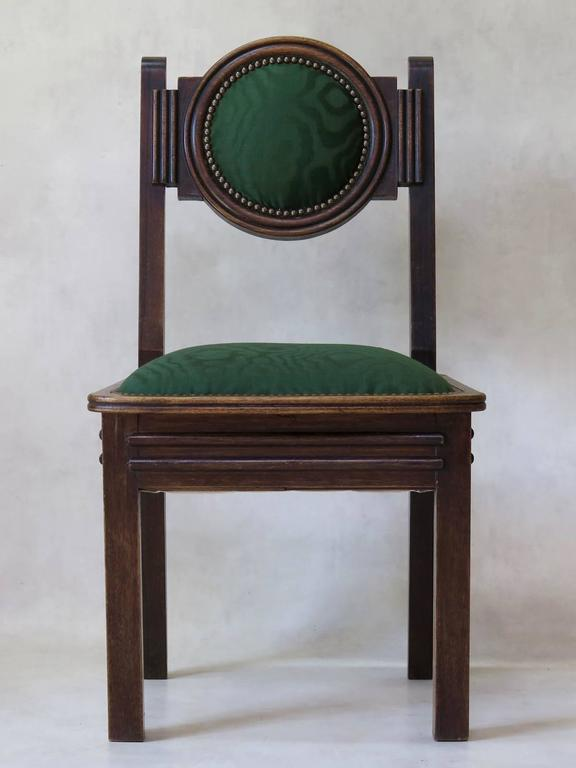 Elegant and rather unusual set of six oak Art Deco dining chairs, with medallion backs. Newly reupholstered with vintage fabric.