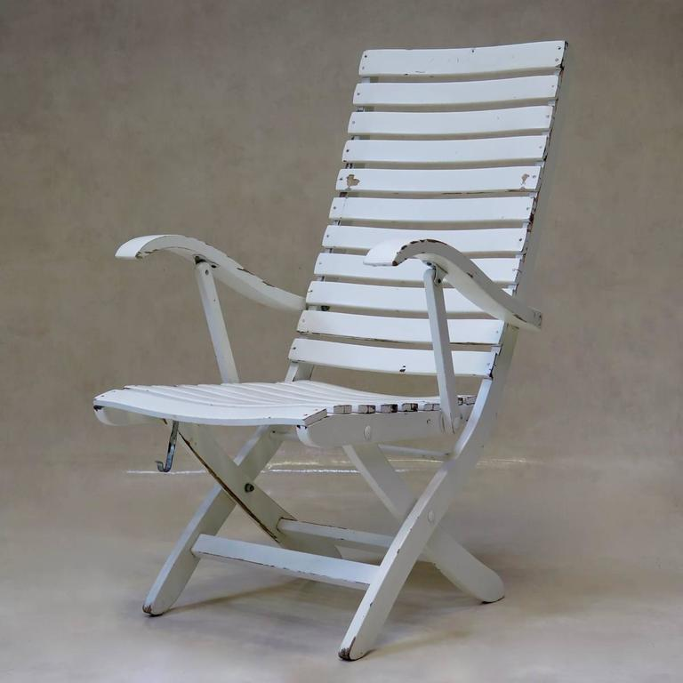 Elegant And Practical Set Of Classic Design Slatted Deck Chairs With  Armrests. Two Positions