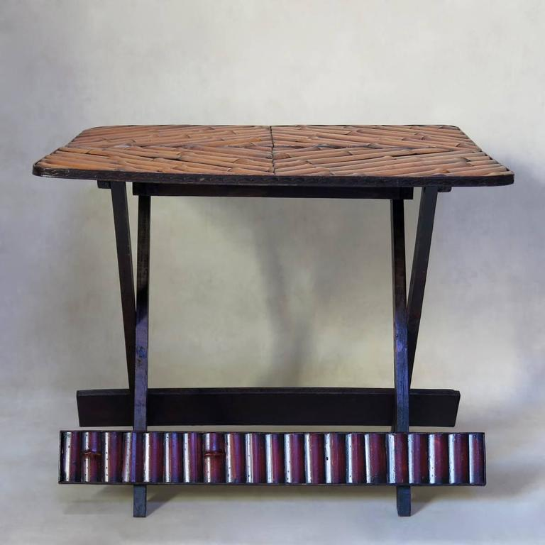 Chic, vintage folding table with a patterned top, and chevron-decorated surround.