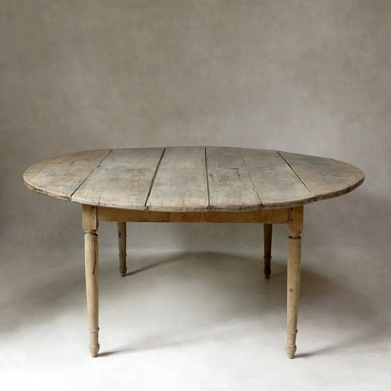 Large Round 19th Century Drop Leaf Oak Dining Table from  : IMG6785l from www.1stdibs.com size 768 x 768 jpeg 32kB