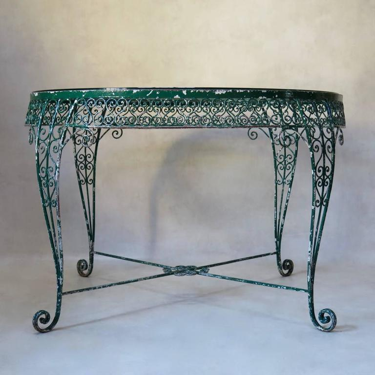 Art Deco Intricately Wrought-Iron Garden Chair and Table, Set, France, 1950s For Sale
