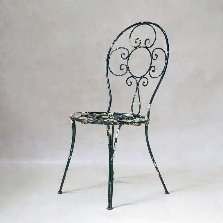 Wrought Iron Intricately Wrought-Iron Garden Chair and Table, Set, France, 1950s For Sale