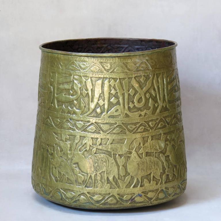 Lovely pair of large oriental copper planters (cache-pots) embossed with decor of arabic calligraphy, animals and foliate friezes.