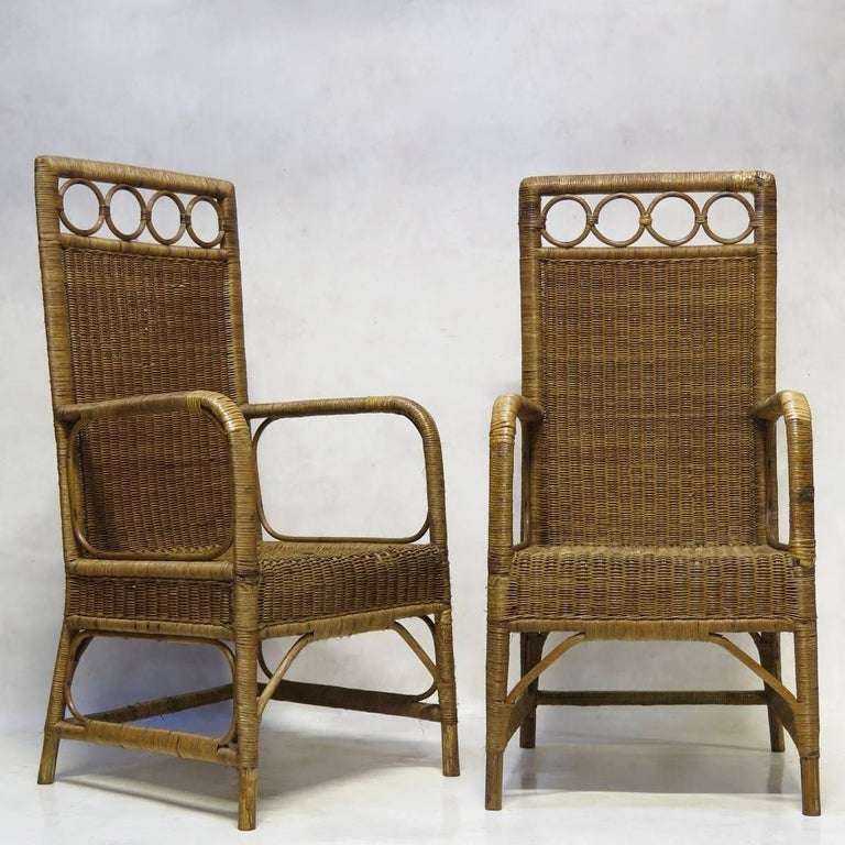 Arts & Crafts style wickerwork set, comprising a settee, two armchairs, two chairs, a table and a pedestal.  The dimensions provided below are for the settee. The other pieces measure:  Armchairs: Height: 115cm - 45.27in Width: 55cm - 21.65in Depth: