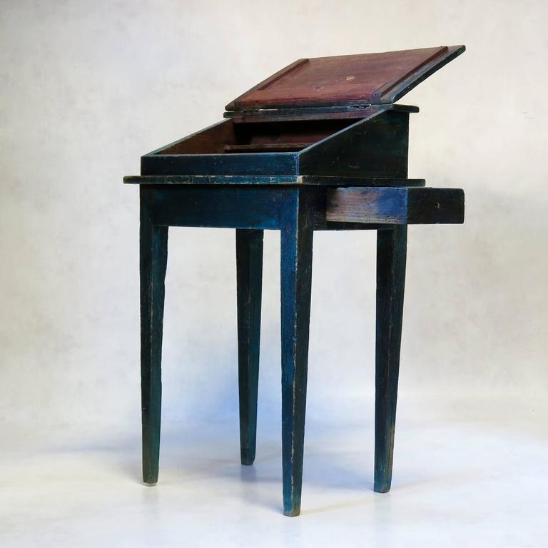 Charming and petite slant top writing desk with a secret little drawer hidden in the side. Lovely deep sea green color with nice patina.