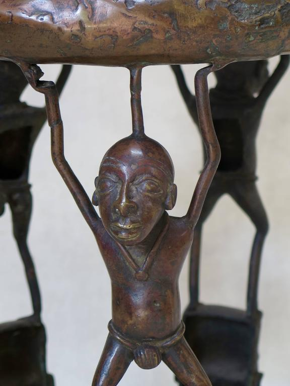 Very lovely bronze stool with nice patina. The seat is decorated with a spider.