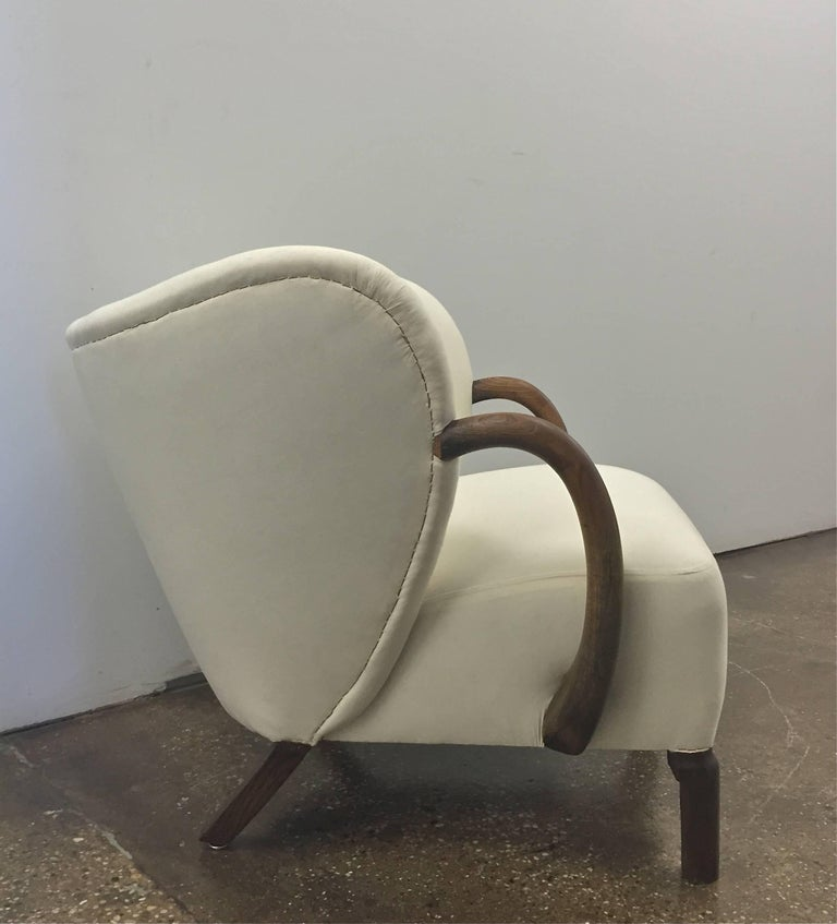 The chair in muslin, design in the style of Viggo Boesen, Denmark, circa 1940. Professionally restored, ready for final upholstery. Related upholstered chairs are illustrated in the 1944 Slagelse Møbelværk catalog.