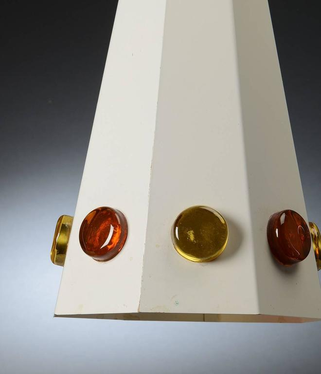 Scandinavian pendant, design attributed to Hans Bergstrom, circa 1970. Made of painted steel in octagonal cone shape, fitted with stained glass. Measures: Height 46 cm. (18