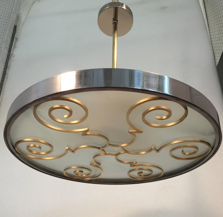 A chandelier by Lars Holmstrӧm for Arvika Konsthantverk,