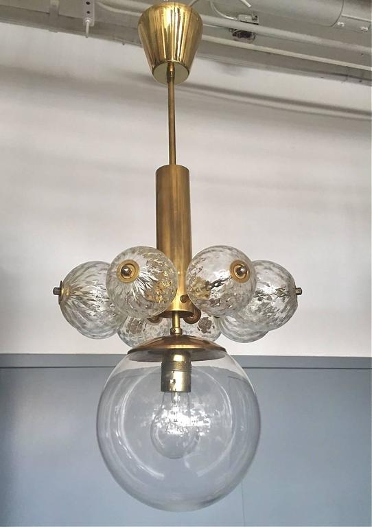 A pair of pendants attributed to Kamenicky Senov manufacture. Czech, circa 1950s. Brass and handblown glass. 