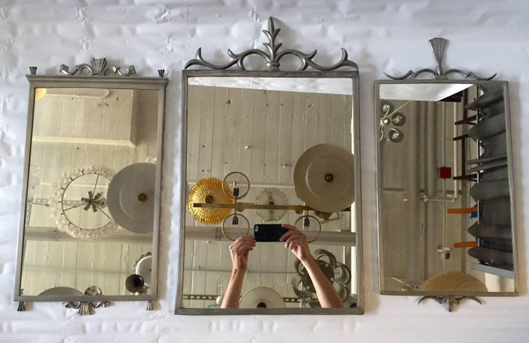 Set of Swedish pewter mirrors. A mirror made by Herman Bergman Art Foundry, Stockholm, 1931. Dimensions: 20