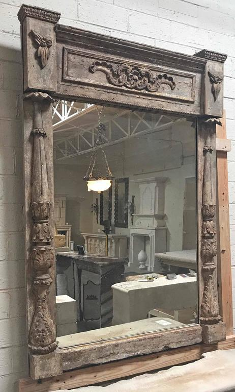 """Antique architectural parcel-gilt framed mirror, the rectangular plate flanked by flared acanthus columns.  Origin: Sweden  circa 1850.  Measurements: 46 3/4"""" W x 4"""" D x 66"""" H."""