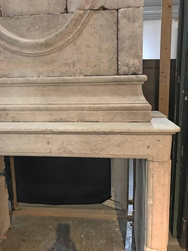 18th Century Limestone Mantel with Hand-Carved Trumeau 3