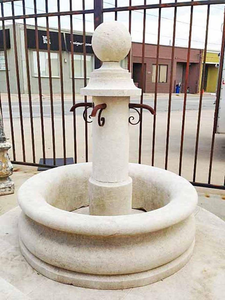 Here we offer an antique limestone fountain that has a basin carved from a single boulder. This piece, reclaimed from the country side outside Bordeaux, France, has been hand-carved top to bottom and was used as a public fountain the 19th century.