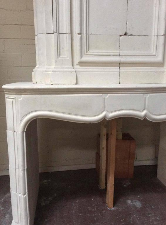 This European fireplace features a masterfully carved trumeau and legs with a scalloped designed mantel. A wonderful piece for any living quarters. Imported from France, circa 1750. The firebox is 50.50
