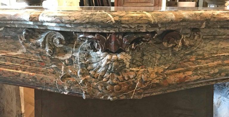 """Violet Breccia marble mantel  Origin: France  circa 1750  Measurements: 77 1/2"""" W x 22"""" D x 47"""" H."""