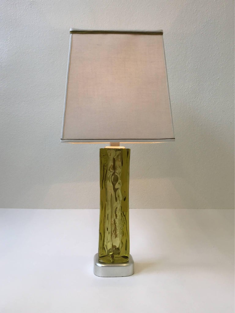 A glamorous Murano glass and silver leaf table lamp by Marbro. The Murano glass has some strokes of gold. The custom white linen shade is original.