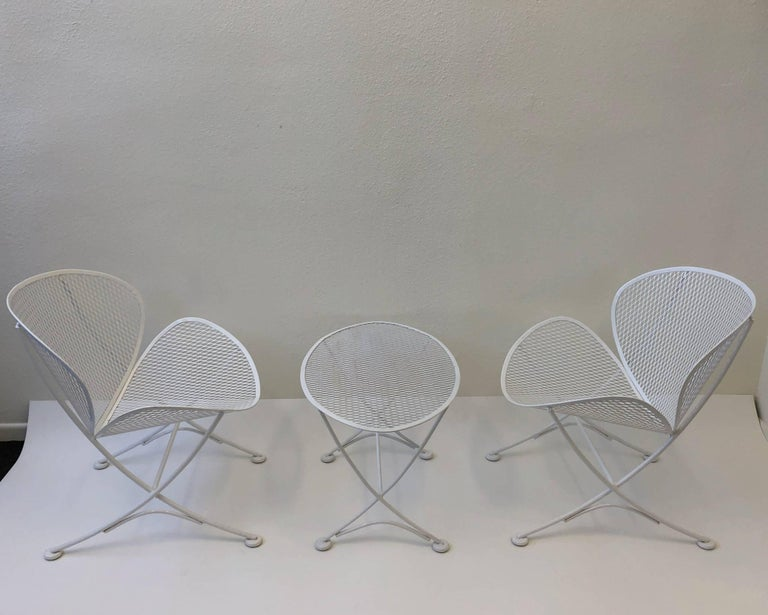 A beautiful design outdoor lounge chairs and side table design in the 1950s by Maurizio Tempestini for Salterini. The set is in great condition.