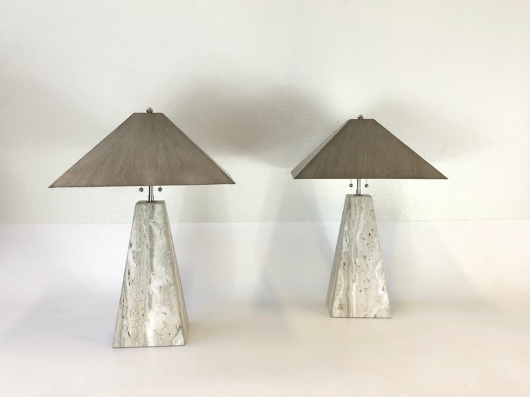 """A spectacular pair of 1970s Italian travertine obelisk shape table lamps. Newly rewired with new polish nickel hardware. The shades are metal with a lacquered finish (see detail photos). Both lamps are marked H.R. Dim: 27"""" high 18""""wide 18"""""""