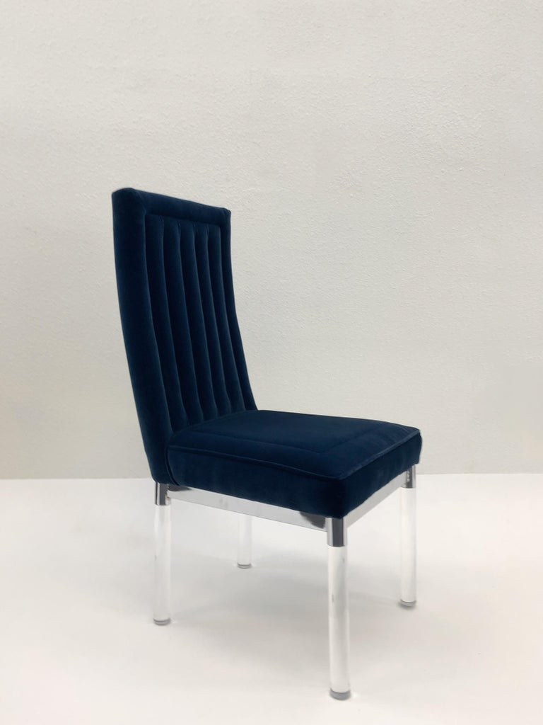 """A glamorous polish chrome and clear acrylic channel back side chair by renowned American designer Charles Hollis Jones. The chair is covered in a soft royal blue velvet. Dimension: 40"""" high, 19"""" wide, 24"""" deep, 18 seat."""