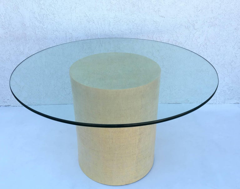 1980s dining table by Steve Chase. The base is raped with grasscloth and then lacquered in a cream color. The top is a 48
