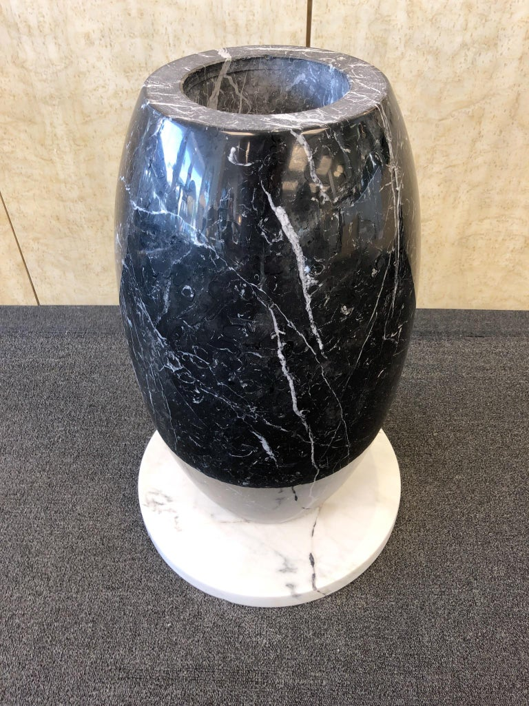 "A spectacular 1980s Italian Carrara and black marble table. The table is in two sections. Newly professionally polished and repaired on the base (see detail photos) The top is 1"" thick and base is 17"" diameter. 